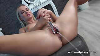 Stunning babe Victoria Pure is pissing and playing with her wet snatch