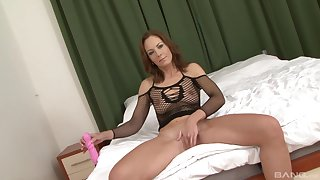 Mature brunette in fishnets Alex Fe pussy gaped unconnected with a black learn of
