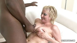 Tow-haired MILF challenges a big hyacinthine cock in a hardcore session