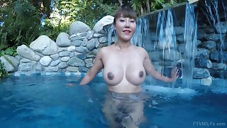Asian exotic MILF Tiffany spreads her pussy in a incorporate