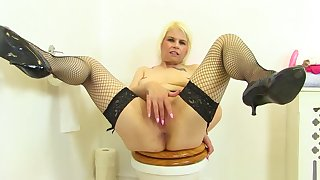English milf Skyler fingers her fanny in the first place toilet