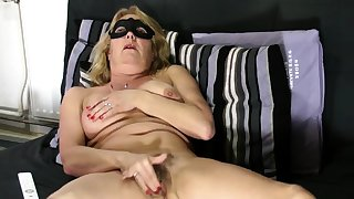 Adult blonde shows hairy pussy