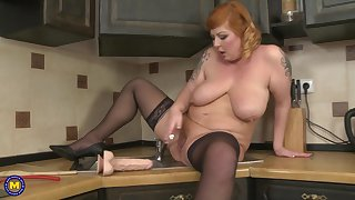 Beamy mature amateur Alex stuffs the brush pussy with toys in the kitchen