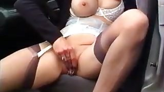 Super MILF woman rubs her pierced pussy in the car