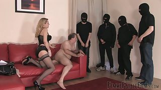 Whorish mistress in stockings corset Eleise de Lacy puts on strapon and punishes fat guy