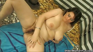 Chubby milf with fat tits masturbates with cucumber